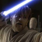 Ewan McGregor with a light sabre